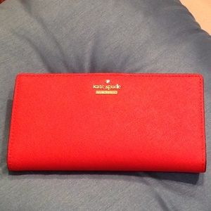 Kate Spade poppy colored wallet.